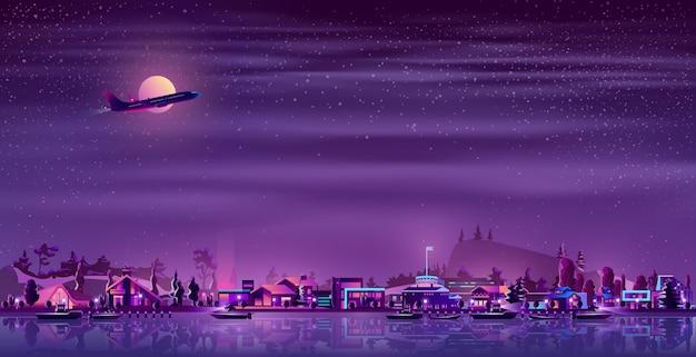 Village de pêcheurs sur le dessin animé néon au bord de mer Vecteur gratuit