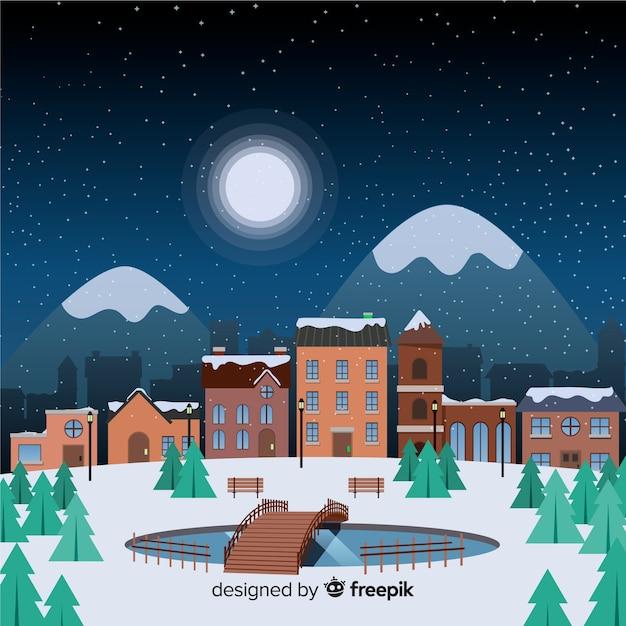 Ville de noël plat une nuit étoilée avec des montagnes Vecteur gratuit