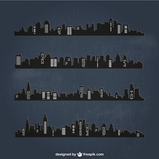 Villes détaillées silhouettes dans la nuit Vecteur gratuit