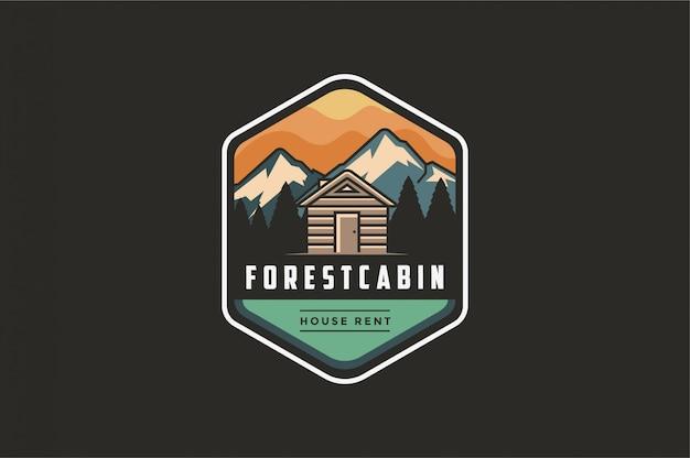 Vintage logo emblème extérieur moderne avec vue sur la montagne et la maison de la cabine en forêt Vecteur Premium