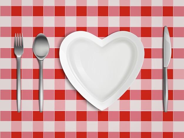 Vue De Dessus D'assiette, Fourchette, Cuillère Et Couteau En Forme De Coeur Vecteur gratuit