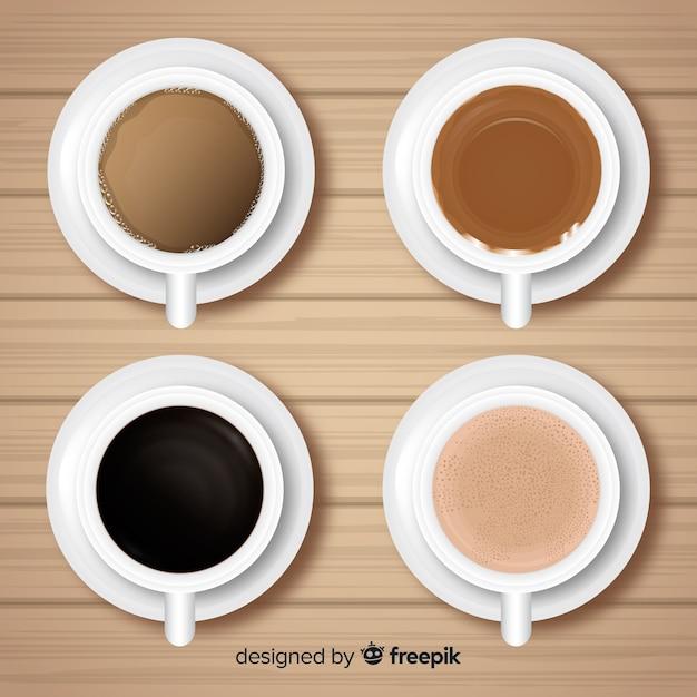 Vue de dessus de la collection de tasses à café avec un design réaliste Vecteur gratuit