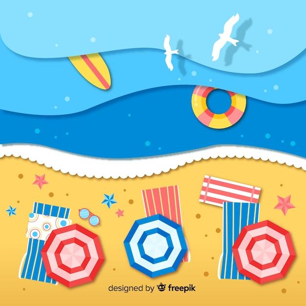 Vue de dessus de plage en arrière-plan de style papier Vecteur gratuit