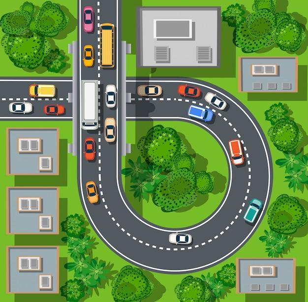 Vue de dessus de la ville depuis les rues, les routes, les maisons et les voitures Vecteur Premium