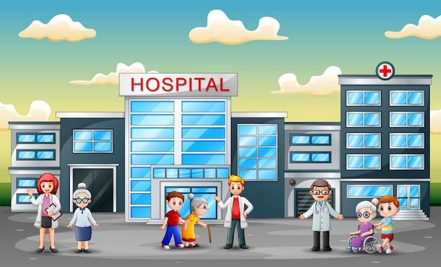 Vue latérale de l'hôpital avec le personnel et l'ambulance Vecteur Premium
