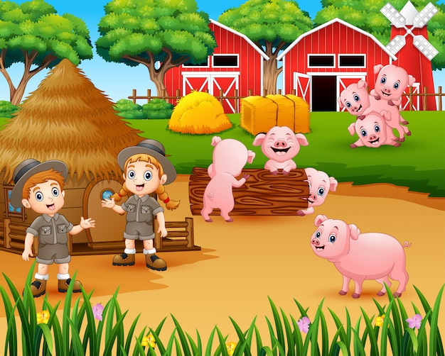 Zookeeper fille et garçon avec des cochons dans la basse-cour Vecteur Premium