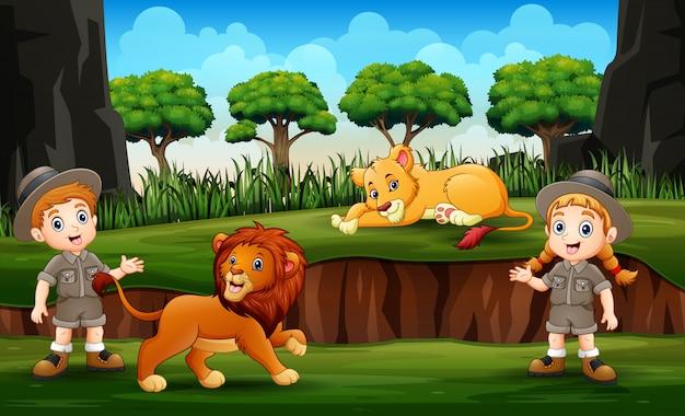 Zookeeper avec des lions sur la nature Vecteur Premium