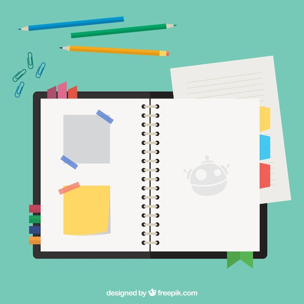 Agenda con notas y lápices vector gratuito