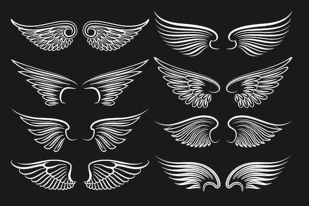 Alas de elementos negros. alas de ángeles y pájaros. ilustración de alas blancas vector gratuito