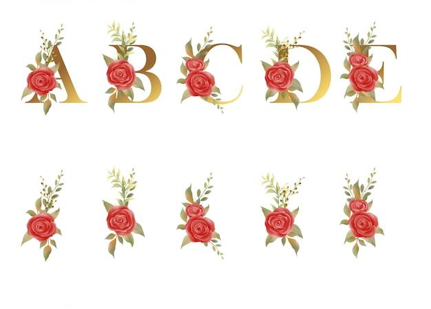 Alfabeto dorado con flores elegantes Vector Premium
