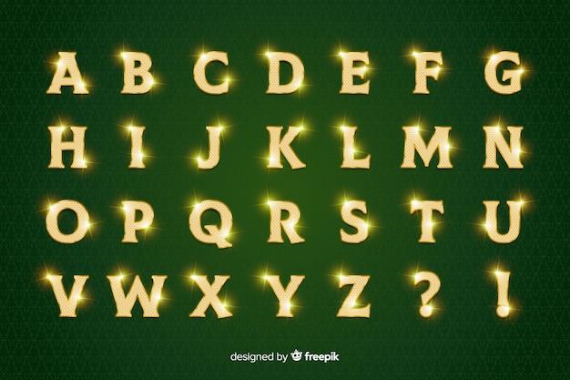 Alfabeto de navidad dorado brillante sobre fondo verde vector gratuito