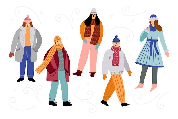 Amigos vistiendo ropa de invierno vector gratuito