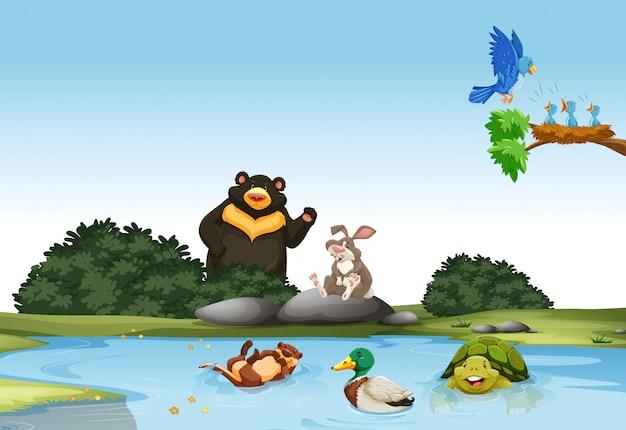 Animales en el campo verde. vector gratuito