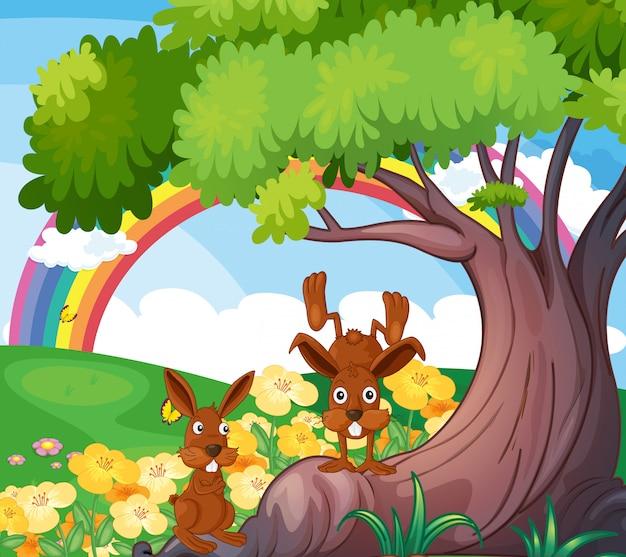 Animales salvajes juguetones bajo el gran árbol. vector gratuito
