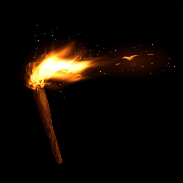 Una antorcha de madera con un fuego ardiente. llama brillante y chispas. Vector Premium