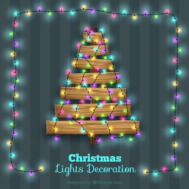 471161acba7 Árbol de navidad hecho de madera con decoración de luces