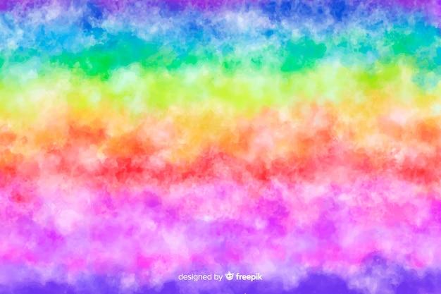 Arco iris en el fondo de estilo tie-dye vector gratuito