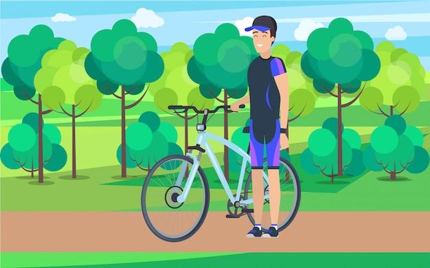 Atleta alegre en pista con bicicleta Vector Premium
