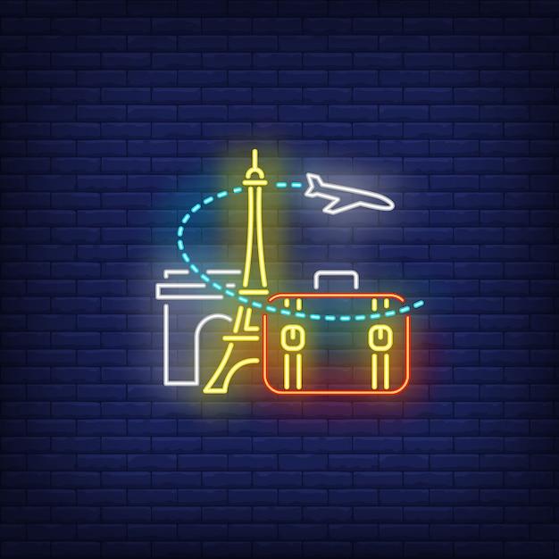 Avión, maleta, torre eiffel y señal de neón del arco del triunfo. vector gratuito
