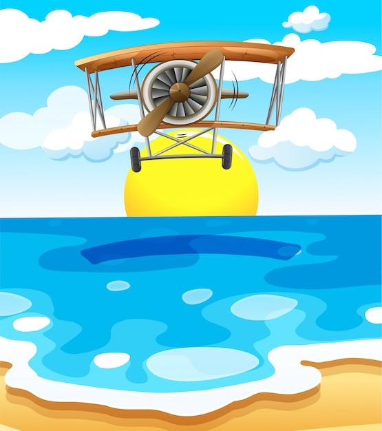 Un avión volando sobre el mar. vector gratuito