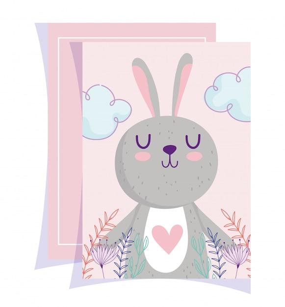 Baby shower, lindo conejito corazón hojas encantadoras tarjeta de dibujos animados floral Vector Premium