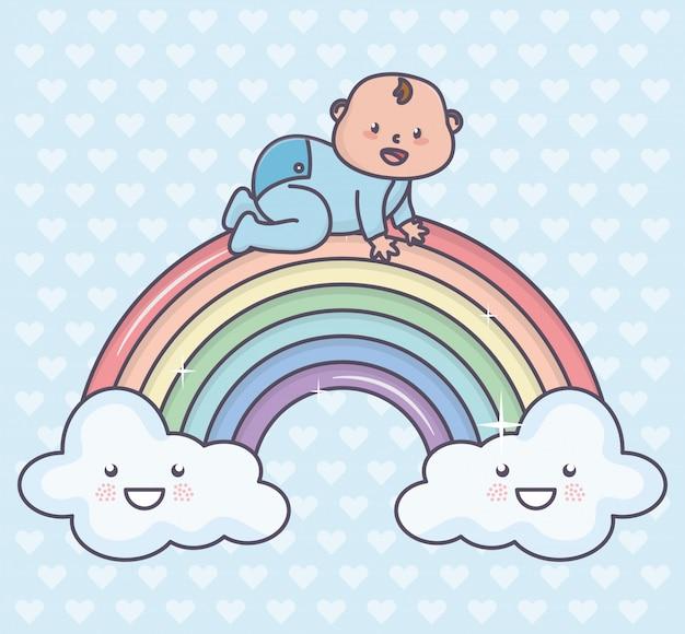 Baby shower lindo niño pequeño en arco iris Vector Premium