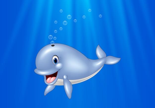 ballena de dibujos animados nadando en el oc233ano