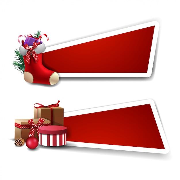 Banner para descuento navideño, plantillas rojas con regalos y medias navideñas con regalos dentro Vector Premium