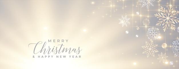 Banner de feliz navidad brillante con copos de nieve brillantes vector gratuito