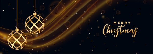 Banner de feliz navidad negro con bolas doradas de navidad vector gratuito