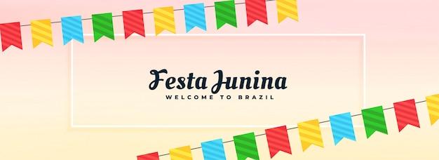 Banner de fiesta junina con decoracion de banderas. vector gratuito