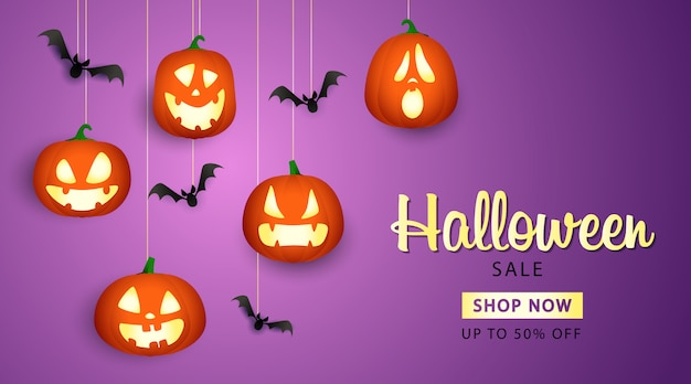 Banner de venta de halloween con linternas de calabaza vector gratuito