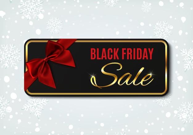 Banner de venta de viernes negro con cinta roja y lazo, sobre fondo de invierno con nieve y copos de nieve. plantilla de diseño para folleto o banner. Vector Premium