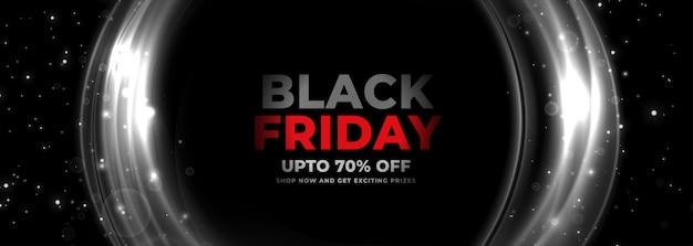 Banner de viernes negro con líneas circulares brillantes vector gratuito
