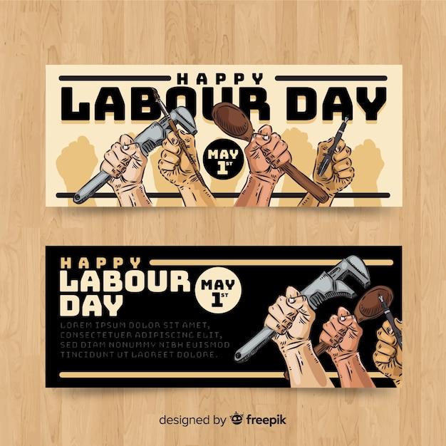 Banners del día del trabajador dibujados a mano vector gratuito