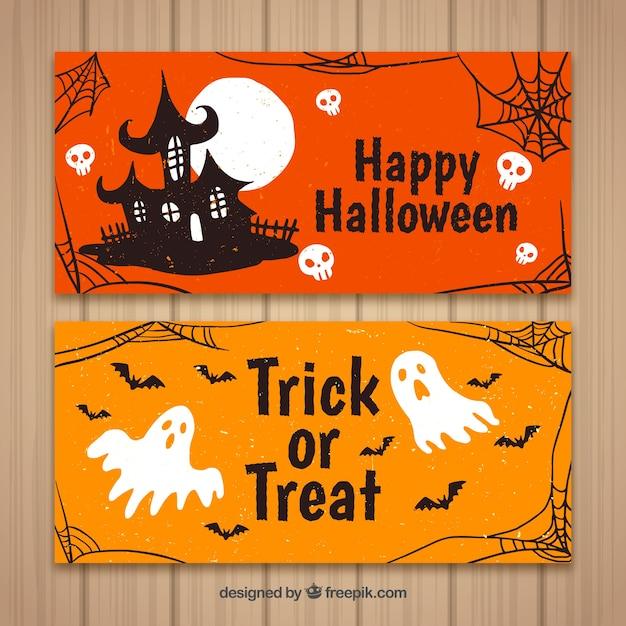 Banners de halloween con casa y fantasmas Vector Premium