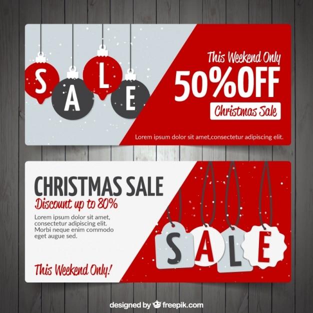 ce204300799 Banners de rebajas de navidad con etiquetas y bolas colgando ...