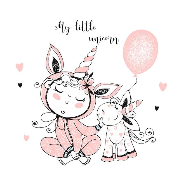 Bebé en pijama con su juguete de unicornio. es hora de dormir. Vector Premium