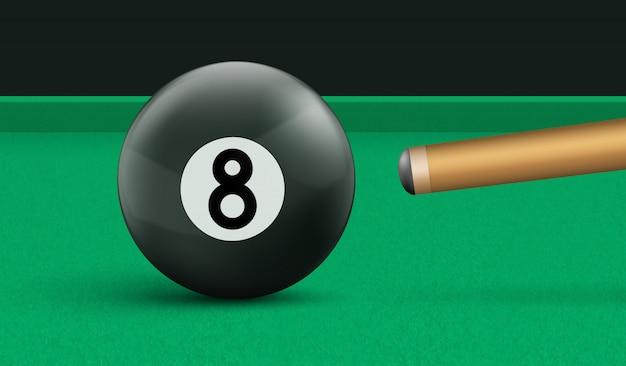 Billar bola ocho y taco sobre mesa de tela verde vector gratuito