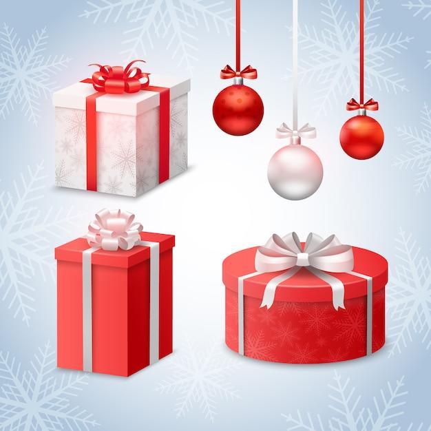 Bolas de navidad y cajas de regalo en el fondo de los copos de nieve vector gratuito