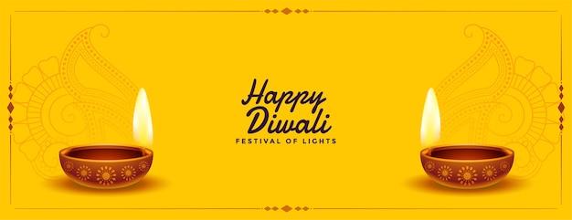 Bonita pancarta amarilla feliz diwali con diya realista vector gratuito