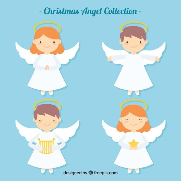 Bonitos ángeles navideños en diseño plano vector gratuito