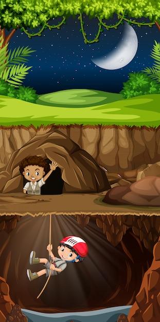 Boy scout explorando la cueva vector gratuito