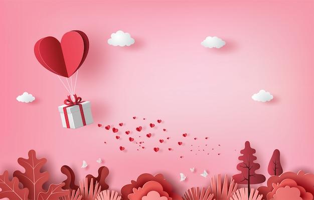 Caja de regalo con globo de corazón flotando en el cielo, pancartas de feliz día de san valentín, estilo de arte en papel Vector Premium