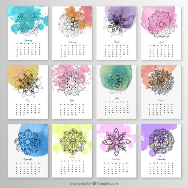 Calendario anual con mandalas y salpicaduras de acuarela vector gratuito