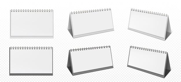Calendario de escritorio con espiral y páginas en blanco aisladas sobre fondo transparente. maqueta realista de calendario de papel blanco, planificador de oficina o bloc de notas de pie sobre la mesa vector gratuito