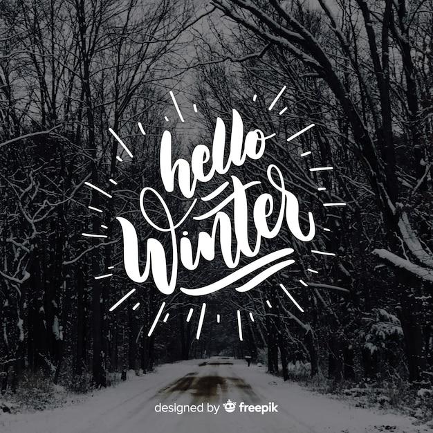 Caligrafía hello winter vector gratuito