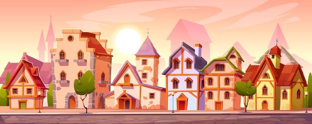 Calle de la ciudad medieval con viejos edificios europeos vector gratuito