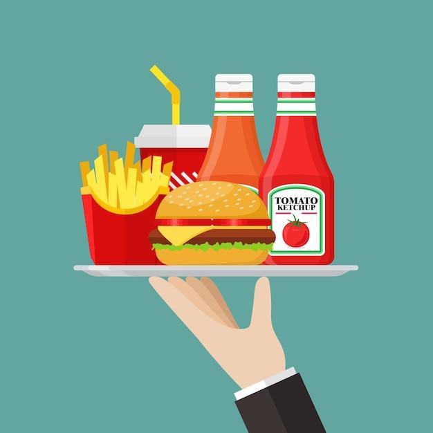 Camarero sirviendo una comida rápida con salsa. Vector Premium