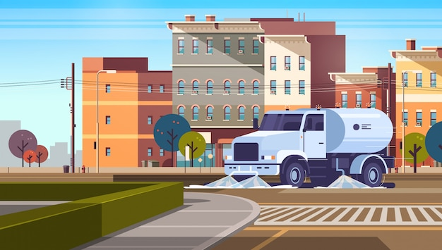 Camión barrendero en el cruce de lavado de asfalto con agua vehículo industrial Vector Premium